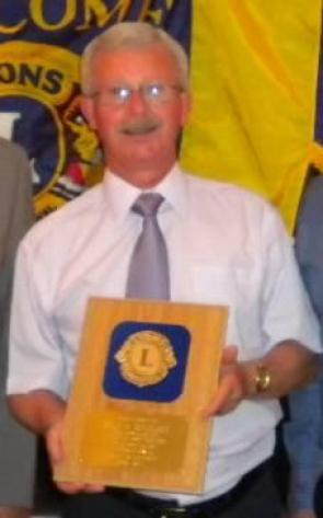 Lion Alan Bailey with his presentation plaque for 39 years of Lions